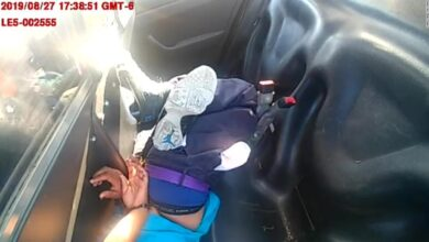 Photo of Colorado police release video of woman restrained with her head on floor of police car crying for help