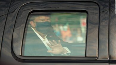 Photo of The President wore a mask and waved as he drove past those gathered outside Walter Reed. This comes after days of contradictory information on his condition.
