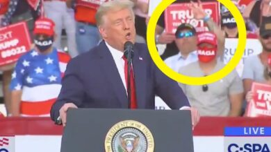 Photo of Video shows a man holding up a hand gesture tied to white supremacy behind Trump at his Florida rally